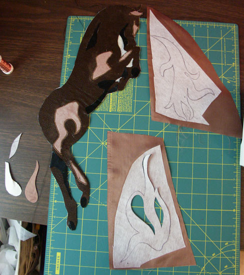 Various pieces laid out, waiting to be sewn.